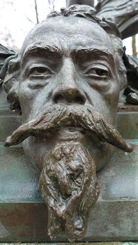 Zacharie Astruc, 1883ca, Mask of Carpeaux, bronze, xx, Jardin de Luxembourg Paris (iR6;aR18;iR1) = SdAF-1883-3293-5, Le Marchand de masques; statue, bronze; Carpeaux